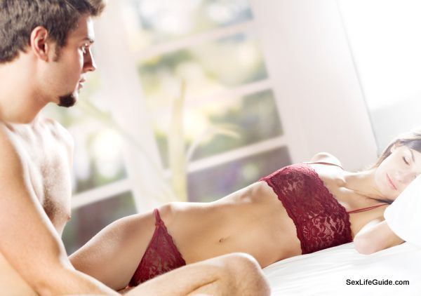 Young couple on the bed in bedroom