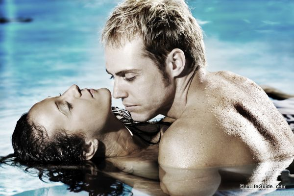 intimate couple in water